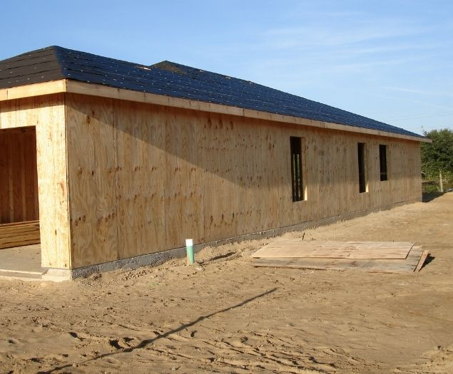 A newly completed shingle roof