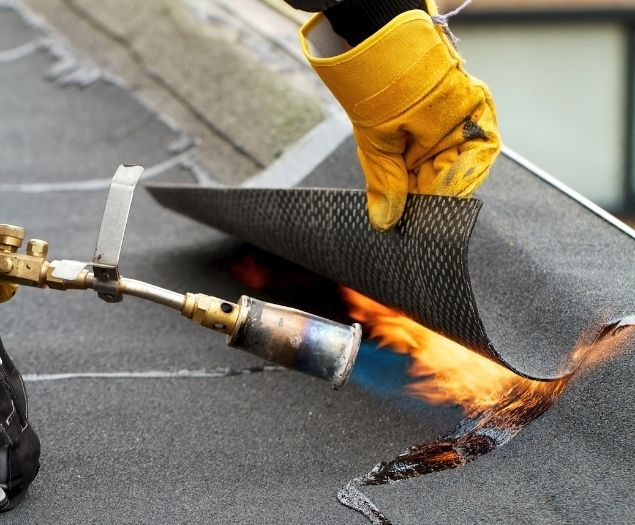 A commercial roof being installed by a professional