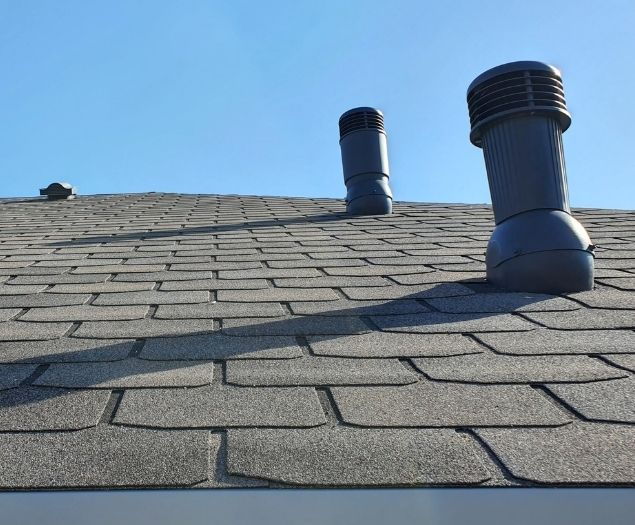 A brand new freshly finished shingled roof.