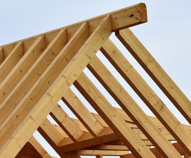 The wooden frame of a new roof being built