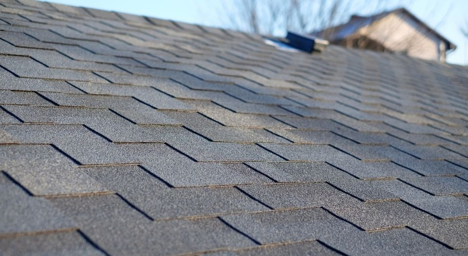 A black shingle roof on a residential home