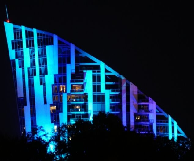 A building in Northern Kentucky lit up by blue lights at night