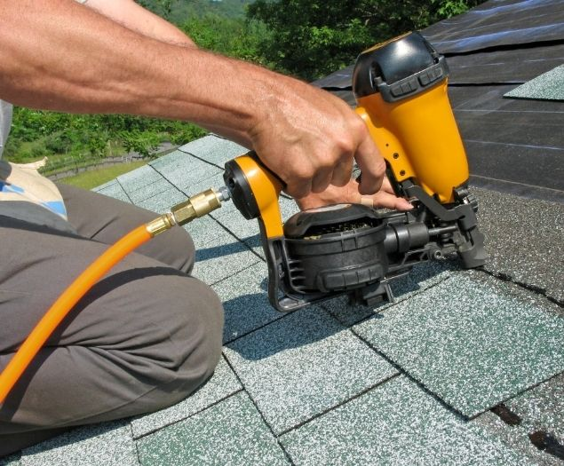 Shingles being installed on a residential home.