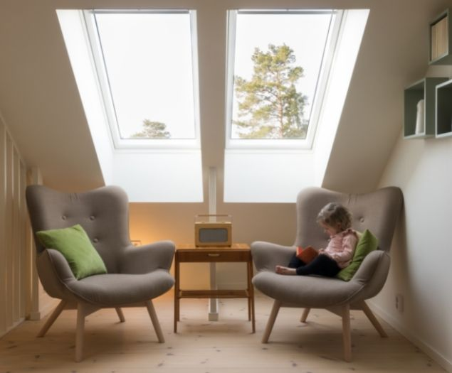 Two side by side skylights installed in an attic room